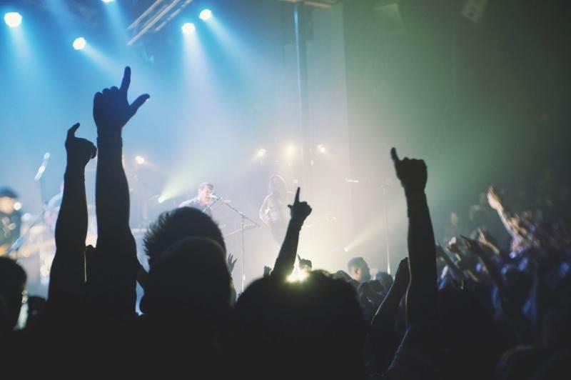 people-raining-hands-at-rock-concert.jpg