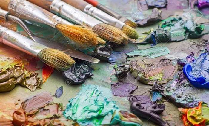 54039131-used-brushes-in-an-artist-s-palette-of-colorful-oil-paint-for-drawing-and-painting.jpg